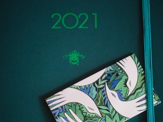 A deep green diary with 2021 embossed in emerald green